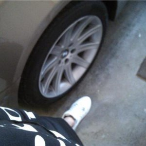it has stock 19in rims...next to my foot (size 10 shoe) ha