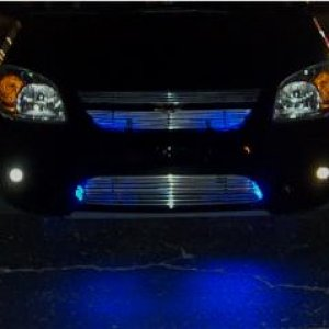 blue neons shining through the grille