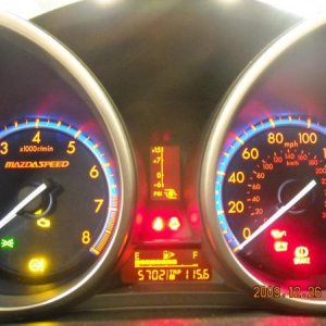 gauge cluster at night with headlights on